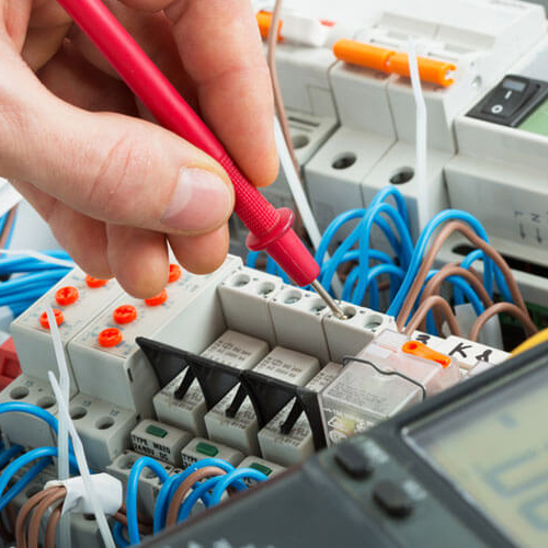 Image shows our electrician working on consumer units in Blackpool
